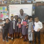 Mr. Evelyn with several students from our 1st grade class.